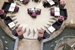 Tables and chairs in big mall Royalty Free Stock Images