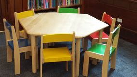 Table and chairs. Childrens seating arrangements in a local library Royalty Free Stock Images