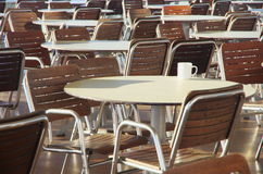 Tables, chairs and a coffee cup Royalty Free Stock Photography