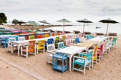 Tables, chairs, colorful seaside Stock Photography