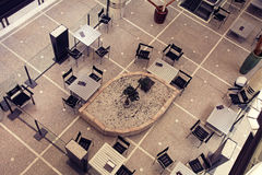 Tables and chairs in contemporary cafe, view from above Stock Photo