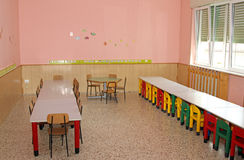 Tables and chairs in the dining hall of the school canteen in a Stock Photo