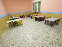 Tables and chairs in the dining hall of a school Stock Photo