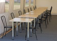 Tables and chairs in the dining room in the tent Stock Images