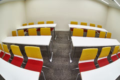 Tables and chairs in an empty classroom Stock Photos