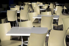 Tables and chairs empty nobody Stock Images