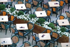 Tables and chairs on empty terrace. Bird's eye view on hotel or restaurant terrace with tables and chairs. Also interesting because of its geometrical pattern Stock Image
