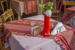 Tables and chairs with floral arrangemenon cafe table Royalty Free Stock Photo