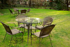Tables and chairs in the garden Royalty Free Stock Image