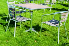 Tables and chairs in the garden Stock Photo
