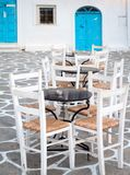 Tables and chairs in a greek island. Close up of tables and chairs in town of Paros, Greece Royalty Free Stock Image