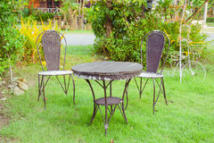 Tables and chairs on green grass Stock Image