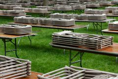Tables and Chairs on a Lawn. Tables and Chairs neatly stacked on a lawn at Harvard Yard, waiting for people to use them at an event Royalty Free Stock Photo
