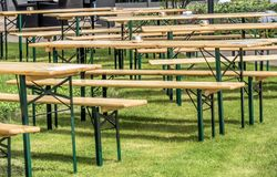 Tables and chairs on a lawn to entertain guests outdoors. Germany royalty free stock photo
