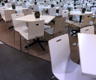 Tables and Chairs Line Up Royalty Free Stock Photography