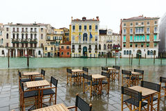 Tables and chairs near Canal Grande (Venice, Italy) Stock Photo