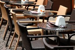 Tables and chairs for an outdoor Cafe in a European metropolis Stock Photography