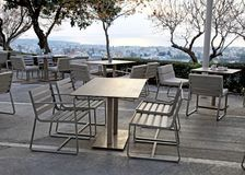 Tables and chairs in outdoor cafe on sunset Royalty Free Stock Photos