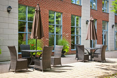 Tables and chairs on outdoor patio Stock Image