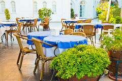 Tables and chairs in outdoor restaurant Stock Image