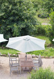 Tables and chairs and parasol Stock Images