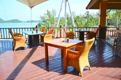 Tables and chairs rattan in restaurant resort. Royalty Free Stock Images