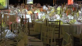 Tables and chairs ready for celebration stock video footage