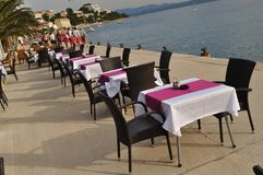 Tables and chairs of restaurant. Podgora, Croatia Royalty Free Stock Image