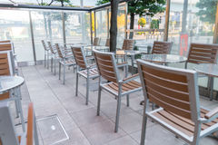 Tables and chairs in restaurant. Stock Photography