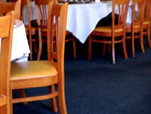 Tables and chairs in restaurant Stock Photos