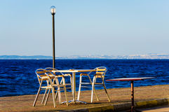 Tables And Chairs On The Seaside Stock Photo