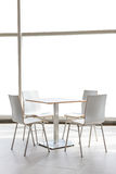 Tables and chairs set on floor Royalty Free Stock Photography