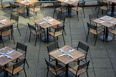 Tables and chairs set for lunchtime Stock Image