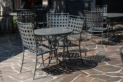 Tables and chairs set up for lunch outside cafe Stock Photos