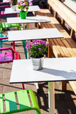 Tables and chairs of a sidewalk cafe Stock Photos