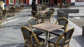 Tables and chairs. Street cafe and restaurants tables and chairs. Outdoors dining place. Outdoor business furnitures Royalty Free Stock Photos