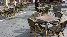 Tables and chairs. Street cafe and restaurants tables and chairs. Outdoors dining place. Outdoor business furnitures Royalty Free Stock Photography