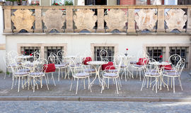 Tables and chairs on the street Stock Images