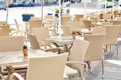 Tables and chairs on a terrace Royalty Free Stock Photos