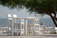 Tables and chairs on terrace of beach restaurant Royalty Free Stock Images