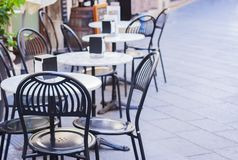Tables with chairs on the terrace in a café in Catania, Sicily, Italy stock image