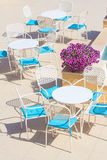 Tables and chairs in terrace cafe Stock Photography