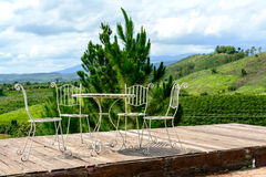 Tables and chairs on terrace nice view over the mountain Stock Images