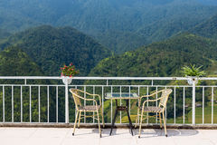 Tables and chairs on terrace and nice view Royalty Free Stock Photo