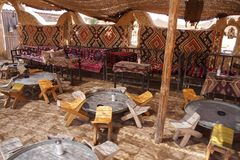 Tables and chairs in traditional desert oasis Royalty Free Stock Images