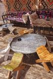 Tables and chairs in traditional desert oasis Stock Images