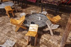 Tables and chairs in traditional desert oasis Royalty Free Stock Image