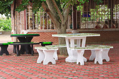 Tables and chairs. Tables and chairs under the tree in the temple Royalty Free Stock Photo