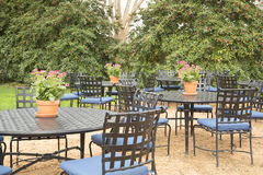 Tables and chairs for visitors in the park Stock Images