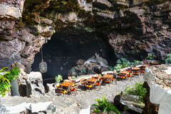 Tables and chairs in volcanic cave in Jameos del Agua, Lanzarote. Canary Islands, Spain Stock Photo